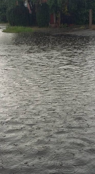 FLOODING: Water on First Avenue (Picture courtesy of Sarah Clipsham)