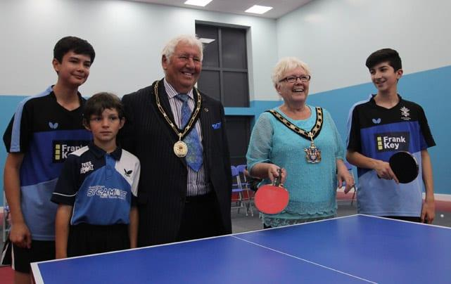 GAME ON: Mayor of Gedling, Cllr Sandra Barnes and Cllr Peter Barnes try their hand at table tennis, watched by, from left, Carlton le Willows student Jak Kane, Cameron Driver from St Peter's CofE Academy in East Bridgford and Lorik Deliu, also from Carlton le Willows.
