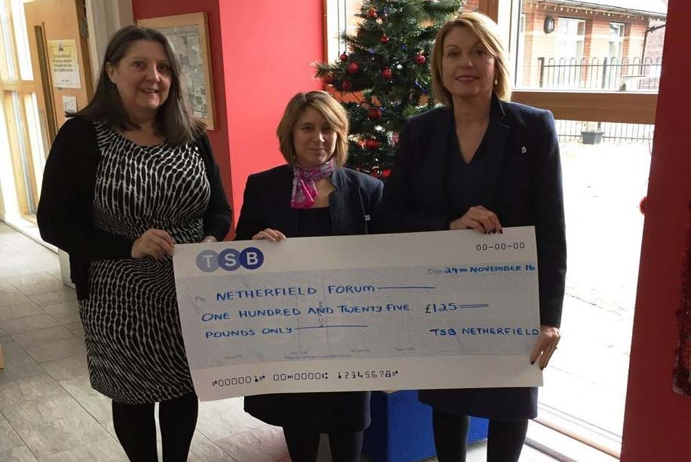 DONATION: TSB present staff present a cheque for £125 to Tina Simpson at St George's Centre.