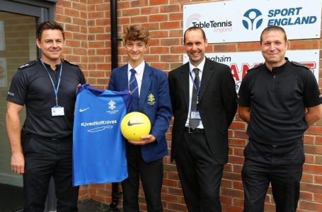 Photo caption: Student and captain of the Year 9 football team Billy Jones and Head of Pastoral Support Dave Hemstock are presented with the new kit by Nottinghamshire Police's PC Paul Kanikowski School and Early Intervention Officer and Inspector Steven O'Neill.
