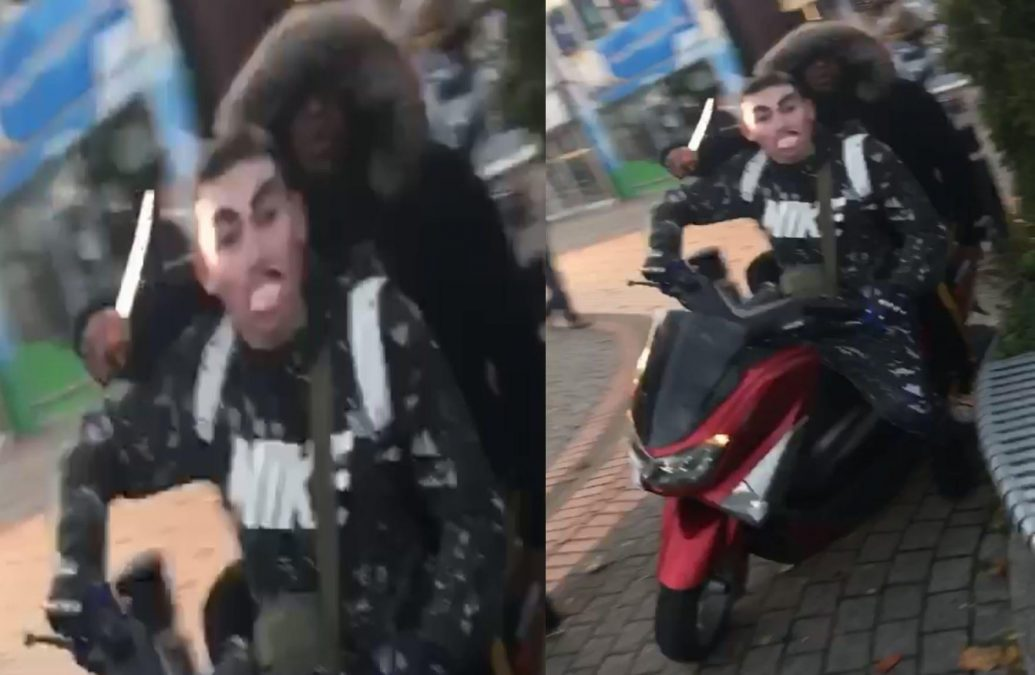 Photo of Two men caught on camera riding around Arnold town centre wielding knife