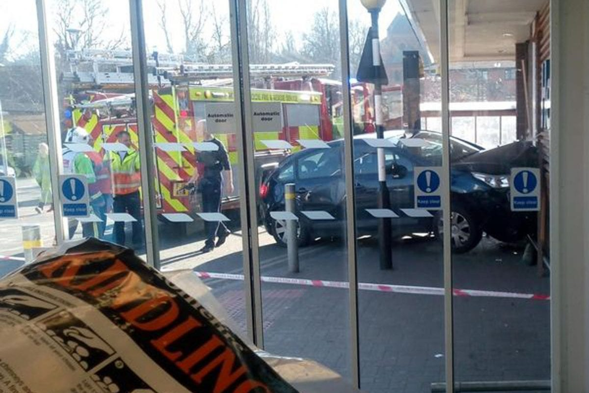 Firefighters rescue woman after car smashes into wall at Tesco in Carlton