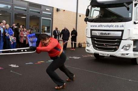 PICTURED: Asha Rani breaks the world record for pulling a truck in high heels