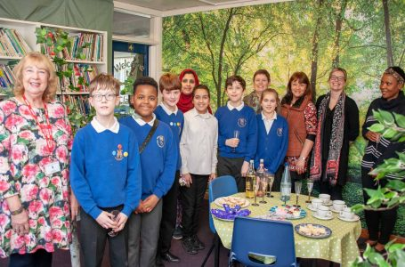 PICTURED: Pupils, teachers and governors are pictured at a launch event for their new library