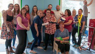 Volunteers decorate school classroom
