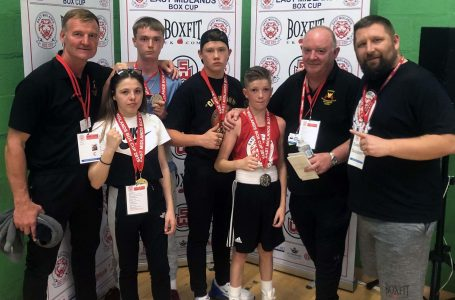 PICTURED: Trainers and young boxers celebrate their success at the recent Box Cup tournament in Grantham