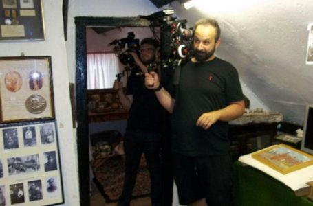 PICTURED: A production team film at the village Folk Museum