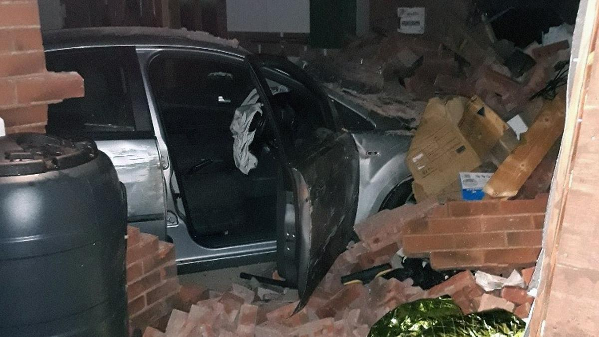 Two arrested after car crashes into house in Arnold
