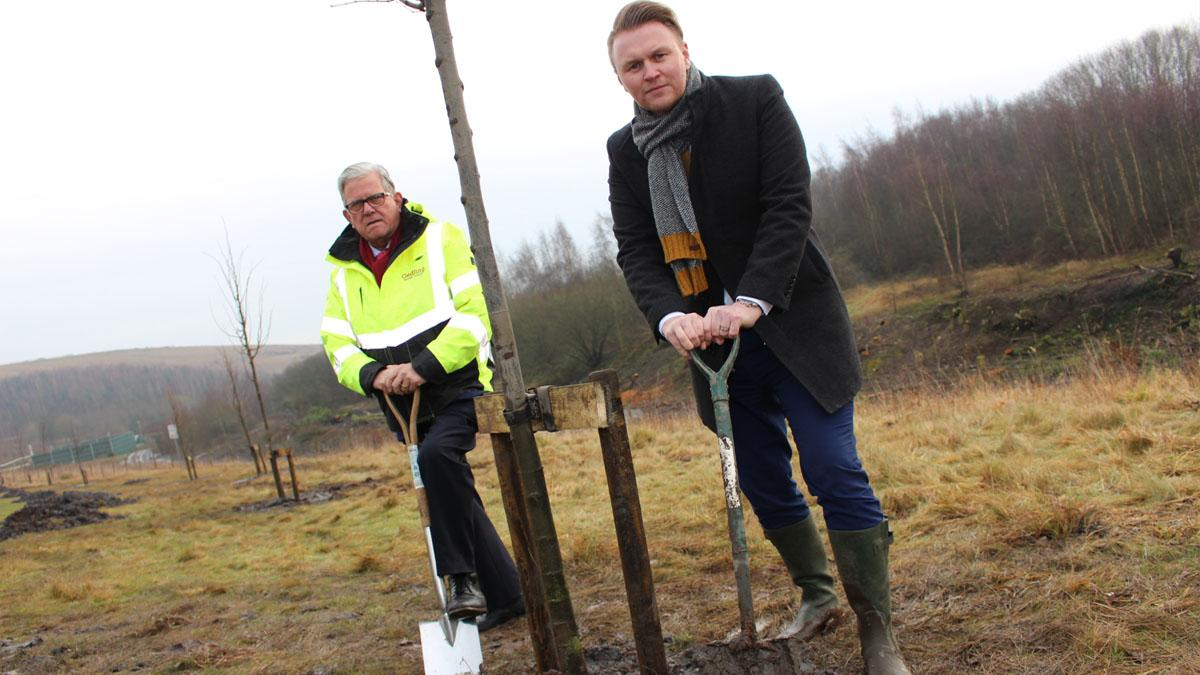 Cllr John Clarke and Michael Payne plant a tree in Gedling Country Park