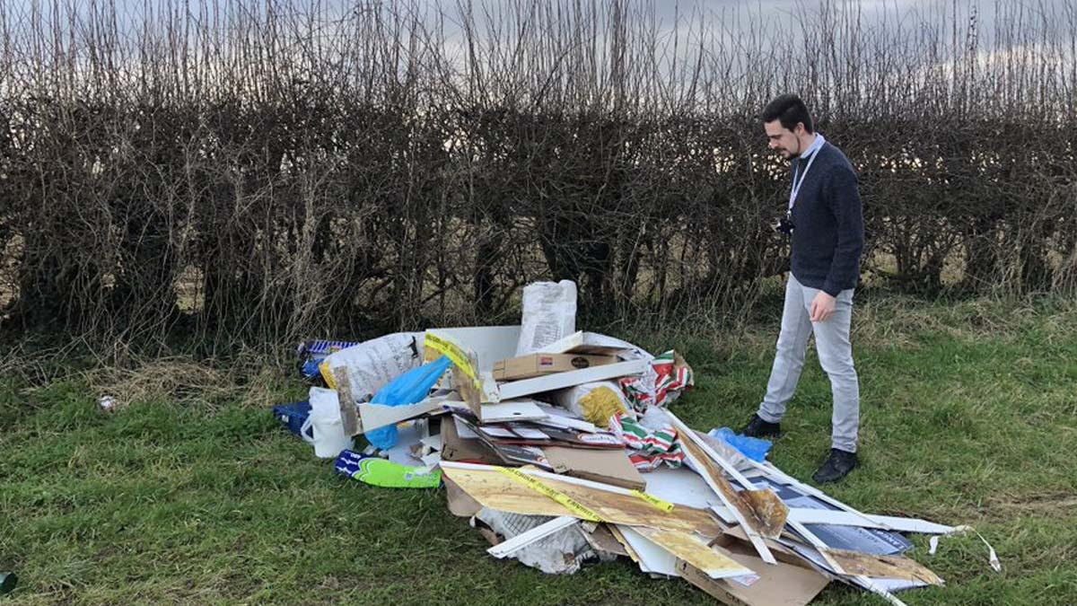 Cllr Sam Smith with rubbish on Stoke Lane in Stoke Bardolph