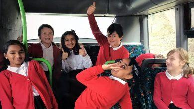 Photo of Pupils climb aboard donated bus which will be soon transformed into unique learning space at Arnold school