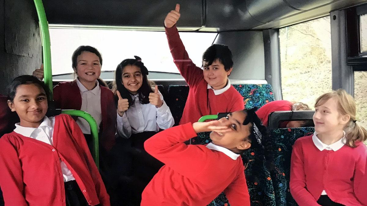 Pupils climb aboard donated bus which will be soon transformed into unique learning space at Arnold school