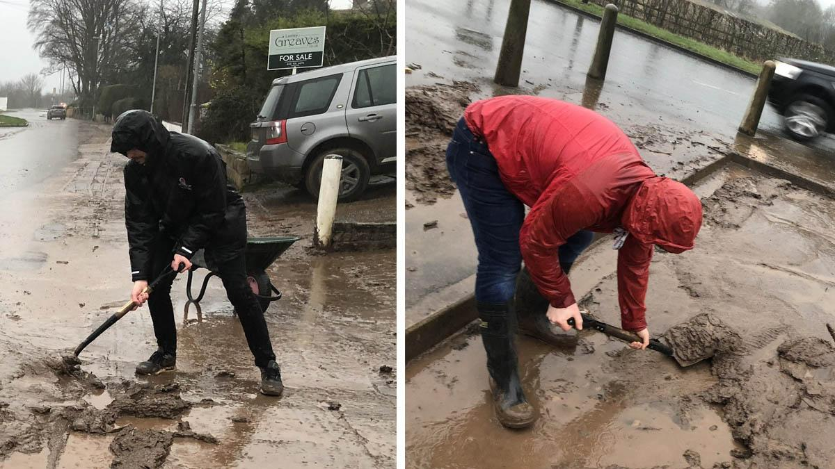 Councillors help clear thick mud that was trapping elderly people in their properties after flooding in Burton Joyce