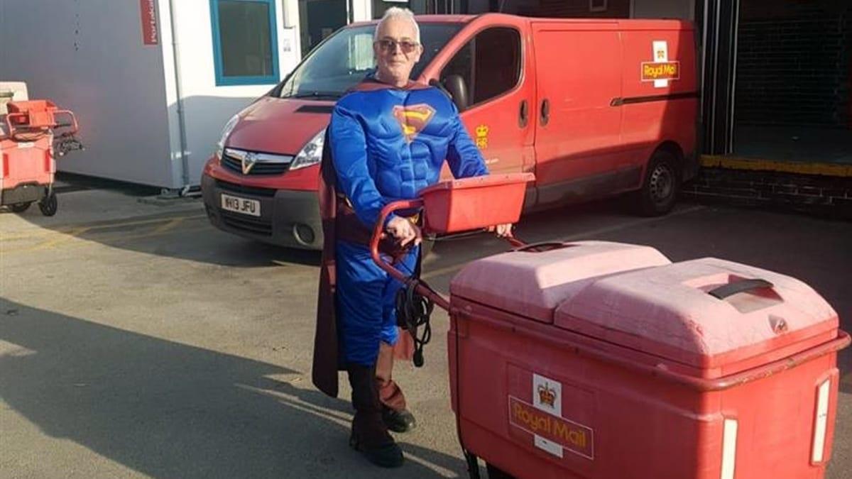 Postman Simon Stevenson on his round dressed as Superman