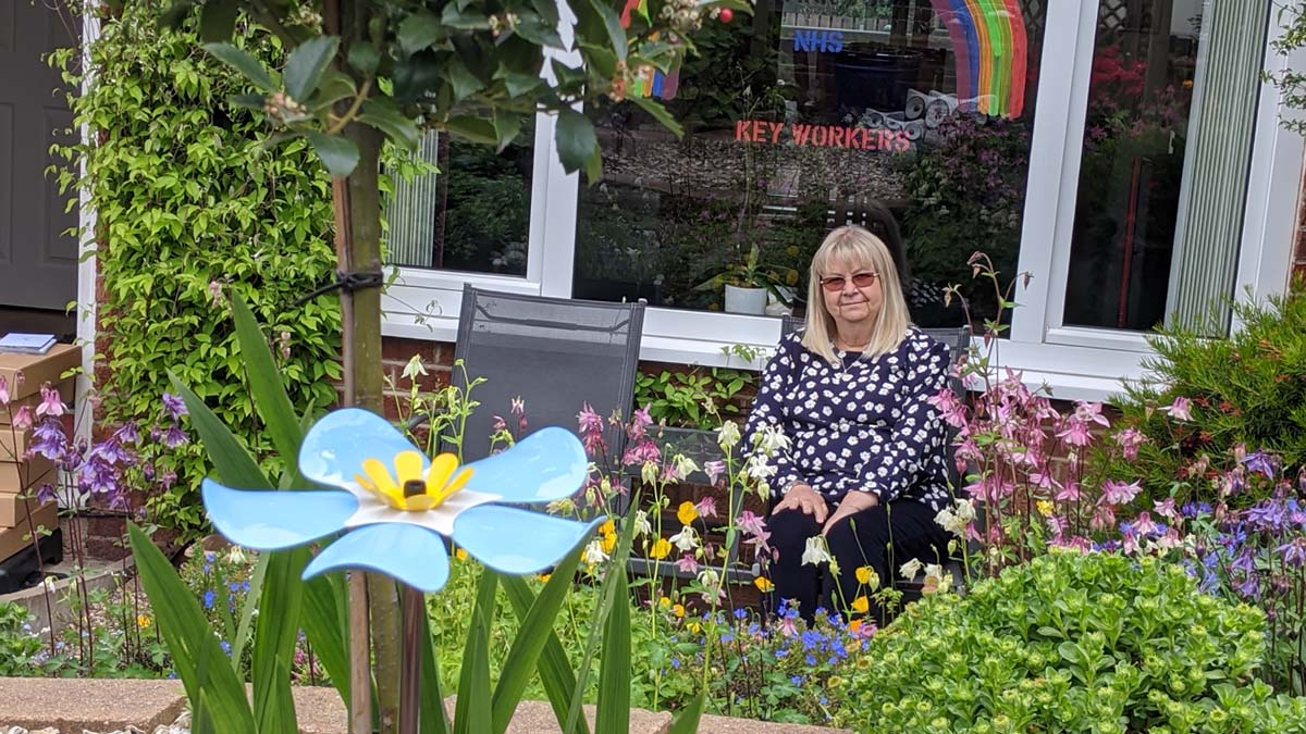 Sheila Hollingsworth with flower