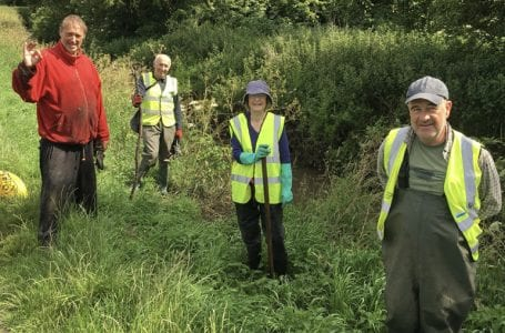 Volunteers clear the Ouse Dyke of balsam