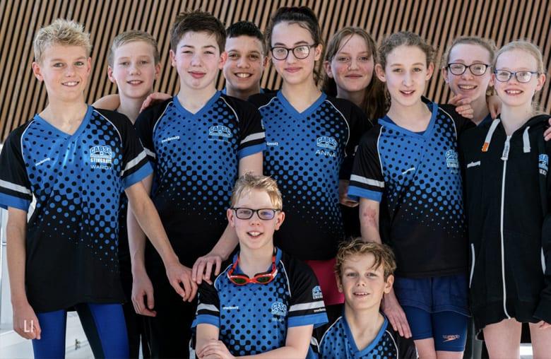 Housebuilder donates £1,000 to swimming club in Calverton