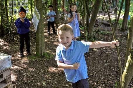 Pupils enjoy the new woodland classroom at Burntstump Seely C of E school