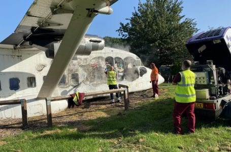 Council workers work on cleaning the plane in St John's playground (PHOTO: Gedling Eye)