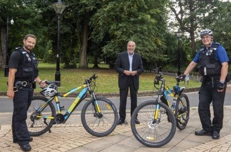 PICTURED: PCC Paddy Tipping with officers on the new electric police bikes