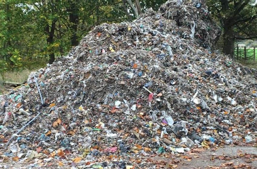 'Stinking' mound of rubbish dumped next to road near Calverton